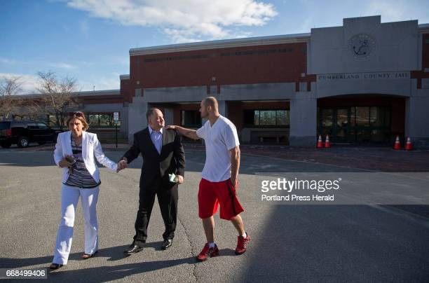 Anthony Sanborn center walks with his wife Michelle Sanborn to their car and says goodbye to Jeff Matthews at left after walking out the door of...