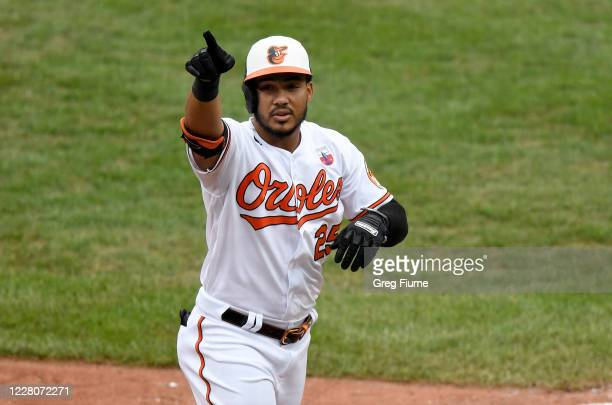 Anthony Santander of the Baltimore Orioles celebrates after hitting a home run in the seventh inning against the Washington Nationals at Oriole Park...
