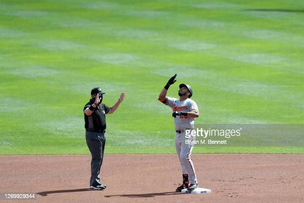 Anthony Santander of the Baltimore Orioles celebrates after hitting a double during the first inning against the Toronto Blue Jays at Sahlen Field on...
