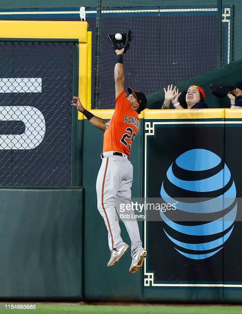 Anthony Santander of the Baltimore Orioles leaps at the wall to catch a fly ball by Yuli Gurriel of the Houston Astros in the sixth inning at Minute...