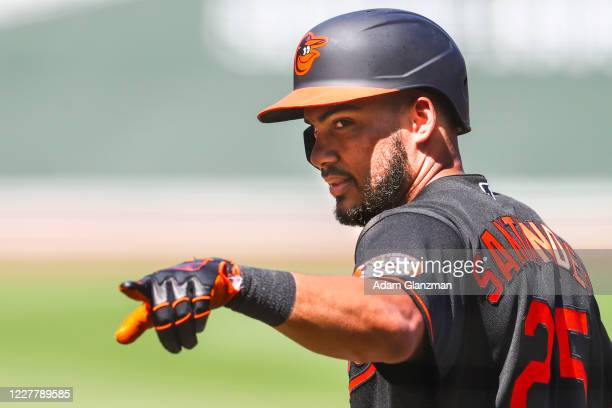 Anthony Santander of the Baltimore Orioles reacts as he returns to the dugout after hitting a two-run home run in the fourth inning of a game against...