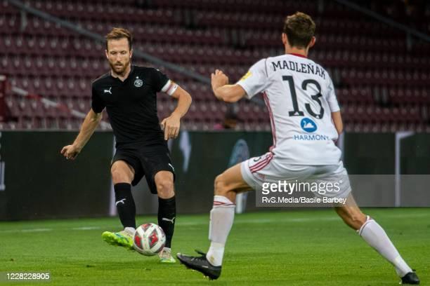 Anthony Sauthier of Servette FC passes ball over Matej Madlenak of MFK Ruzomberok during the UEFA Europa League qualification match between Servette...