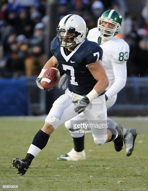 Anthony Scirrotto of the Penn State Nittany Lions returns an interception in front of Charlie Gantt of the Michigan State Spartans on November 22...