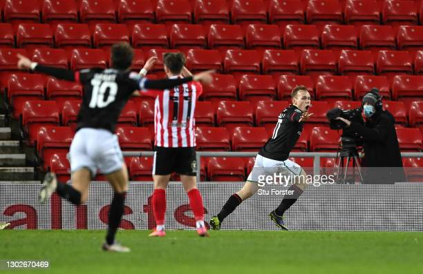 Anthony Scully of Lincoln City celebrates after scoring their side's first goal during the Papa John's Trophy Semi-Final match between Sunderland and...