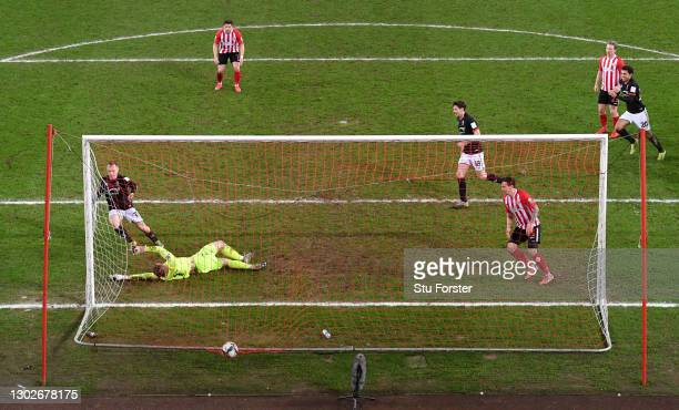 Anthony Scully of Lincoln City scores their side's first goal during the Papa John's Trophy Semi-Final match between Sunderland and Lincoln City on...