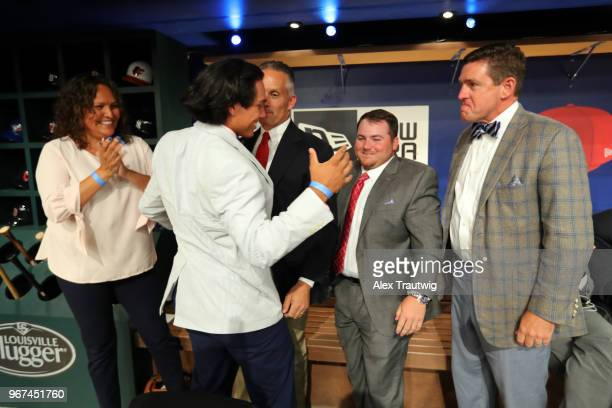 Anthony Seigler celebrates with his family after being selected 23rd overall by the New York Yankees during the 2018 Major League Baseball Draft at...