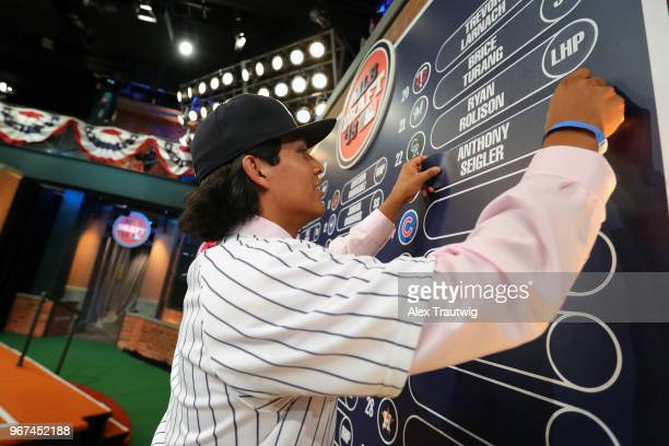 Anthony Seigler who was drafted 23rd overall by the New York Yankees puts his nameplate on the draft board during the 2018 Major League Baseball...