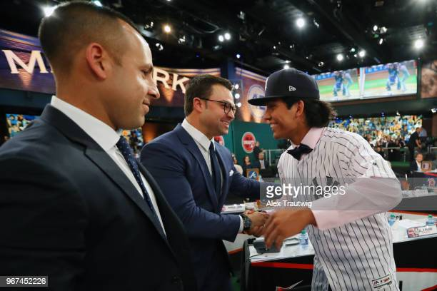 Anthony Seigler who was drafted 23rd overall by the New York Yankees shakes hands with Nick Swisher during the 2018 Major League Baseball Draft at...