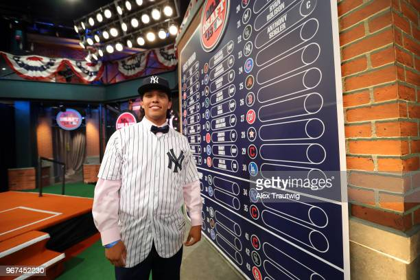 Anthony Seigler who was drafted 23rd overall by the New York Yankees poses for a photo by the draft board during the 2018 Major League Baseball Draft...