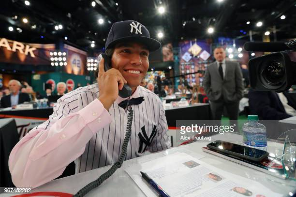 Anthony Seigler who was drafted 23rd overall by the New York Yankees talks to the Yankees front office during the 2018 Major League Baseball Draft at...