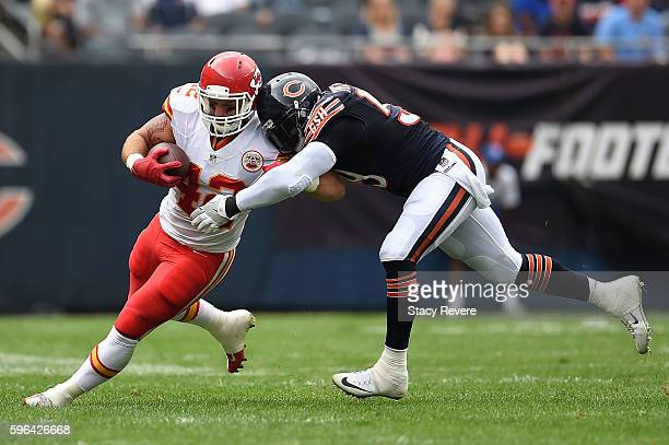 Anthony Sherman of the Kansas City Chiefs is brought down by Danny Trevathan of the Chicago Bears during a preseason game at Soldier Field on August...