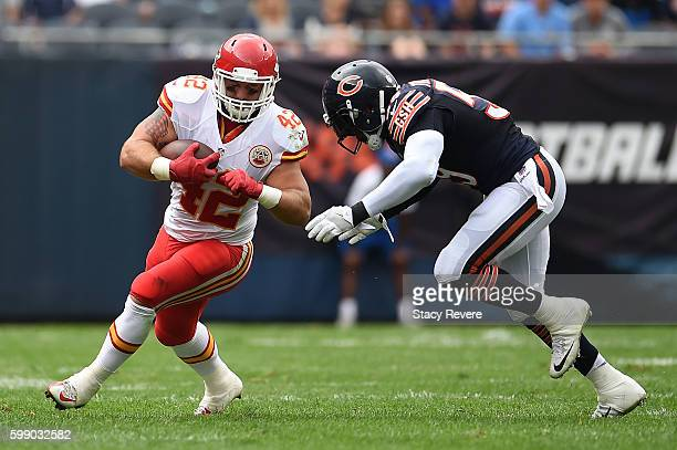 Anthony Sherman of the Kansas City Chiefs is pursued by Danny Trevathan of the Chicago Bears during a game at Soldier Field on August 27 2016 in...