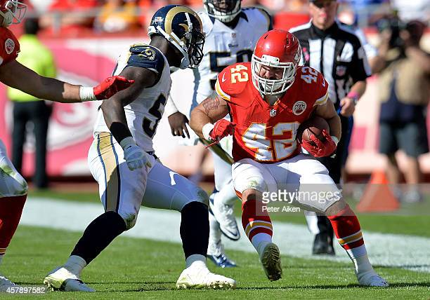 Anthony Sherman of the Kansas City Chiefs runs the ball against Alec Ogletree of the St Louis Rams at Arrowhead Stadium on October 26 2014 in Kansas...