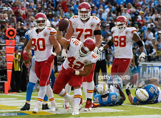 Anthony Sherman of the Kansas City Chiefs spikes the football after scoring a touchdown against the San Diego Chargers during an NFL game at Qualcomm...