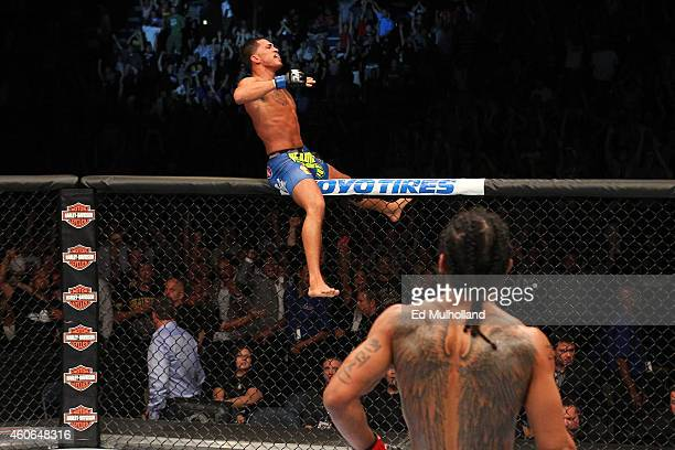Anthony 'Showtime' Pettis celebrates after defeating Benson Henderson in their UFC lightweight championship bout at BMO Harris Bradley Center on...