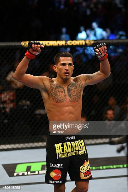 Anthony 'Showtime' Pettis celebrates defeating Donald Cerrone during their Lightweight Bout part of UFC on FOX at United Center on January 26 2013 in...