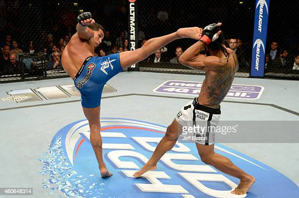 Anthony 'Showtime' Pettis kicks Benson Henderson in their UFC lightweight championship bout at BMO Harris Bradley Center on August 31 2013 in...