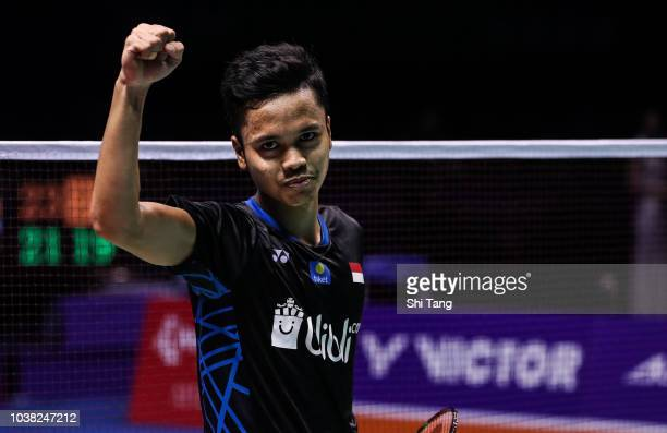 Anthony Sinisuka Ginting of Indonesia celebrates the victory after the Men's Single final match against Kento Momota of Japan on day six of the China...