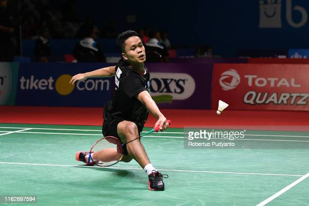 Anthony Sinisuka Ginting of Indonesia competes against Kantaphon Wangcharoen of Thailand on day three of the Bli Bli Indonesia Open at Istora Gelora...