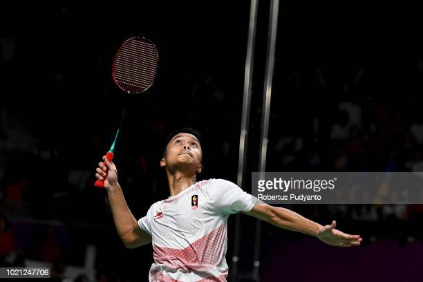Anthony Sinisuka Ginting of Indonesia competes against Shi Yuqi of China during Men's Team final match between Indonesia and China on day four of the...