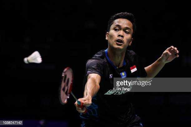 Anthony Sinisuka Ginting of Indonesia competes in the Men's Single final match against Kento Momota of Japan on day six of the China Open at Olympic...