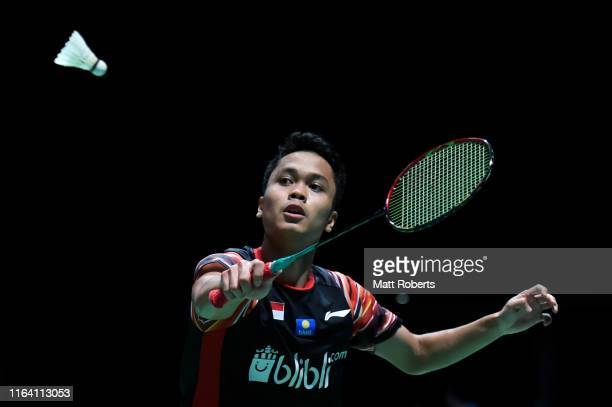 Anthony Sinisuka Ginting of Indonesia competes in the men's singles match against Sitthikom Thammasin of Thailand on day two of the Daihatsu Yonex...