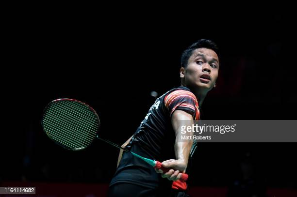 Anthony Sinisuka Ginting of Indonesia competes in the men's singles match against Sitthikom Thammasin of Thailand on day three of the Daihatsu Yonex...