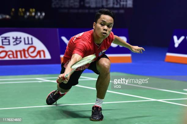 Anthony Sinisuka Ginting of Indonesia competes in the Men's Singles final match against Kento Momota of Japan on day six of 2019 China Badminton Open...