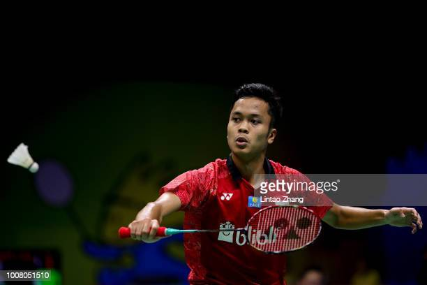 Anthony Sinisuka Ginting of Indonesia hits a shot against Suppanyu Avihingsanon of Thailand in their Men's singles match during the day two of Total...