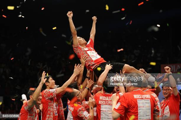 Anthony Sinisuka Ginting of Musica Champions Indonesia is lifted after beating Shesar Hiren Rhustavito of PB Djarum Indonesia during the Mens team...