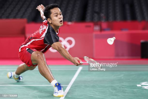 Anthony Sinisuka Ginting of Team Indonesia competes against Chen Long of Team China during a Men's Singles Semi-final match on day nine of the Tokyo...