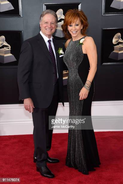 Anthony 'Skeeter' Lasuzzo and recording artist Reba McEntire attends the 60th Annual GRAMMY Awards at Madison Square Garden on January 28 2018 in New...