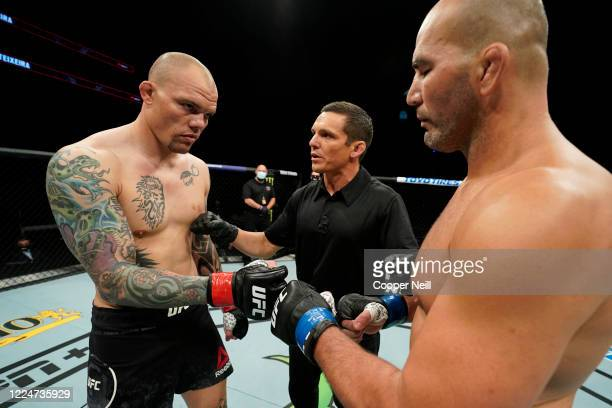 Anthony Smith and Glover Teixeira of Brazil touch gloves prior to their light heavyweight bout during the UFC Fight Night Event at VyStar Veterans...