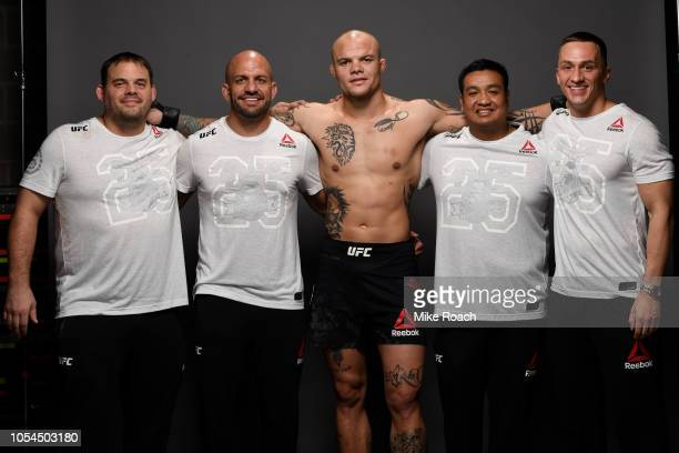 Anthony Smith poses for a portrait backstage with his team after his victory over Volkan Oezdemir during the UFC Fight Night event inside Avenir...