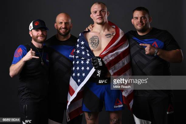 Anthony Smith poses for a post fight portrait backstage with his team during the UFC Fight Night event at Sprint Center on April 15 2017 in Kansas...