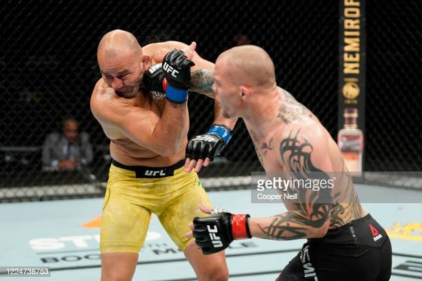 Anthony Smith punches Glover Teixeira of Brazil in their light heavyweight bout during the UFC Fight Night Event at VyStar Veterans Memorial Arena on...