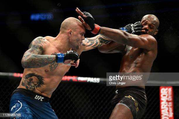 Anthony Smith punches Jon Jones in their light heavyweight championship bout during the UFC 235 event at TMobile Arena on March 2 2019 in Las Vegas...