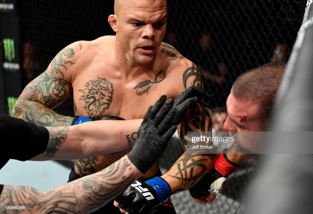 Anthony Smith punches Mauricio Rua of Brazil in their light heavyweight bout during the UFC Fight Night at Barclaycard Arena on July 22, 2018 in Hamburg, Germany.