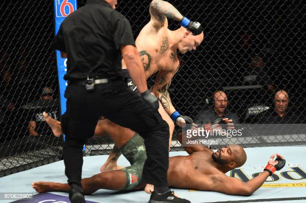 Anthony Smith punches Rashad Evans in their light heavyweight fight during the UFC 225 event at the United Center on June 9 2018 in Chicago Illinois