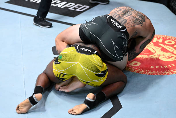 Anthony Smith secures a rear choke submission against Ryan Spann in a light heavyweight fight during the UFC Fight Night event at UFC APEX on...