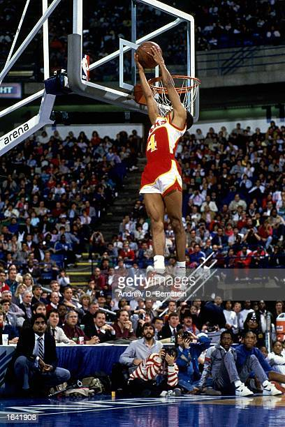 Anthony 'Spud' Webb of the Atlanta Hawks goes up for a reverse slam dunk during the NBA AllStar Slam Dunk contest at Reunion Arena on February 8 1986...
