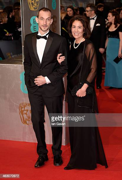 Anthony Stacchi and guest attend the EE British Academy Film Awards at The Royal Opera House on February 8 2015 in London England