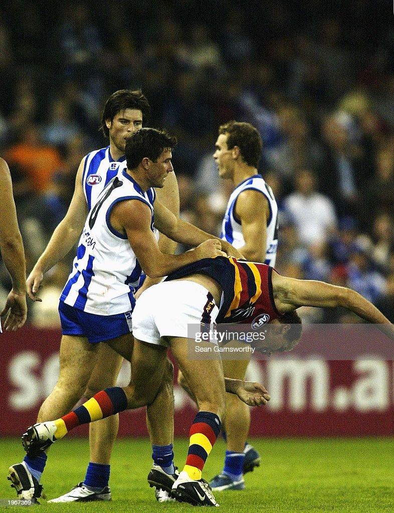 Anthony Stevens for the Kangaroos pushes Carey : News Photo