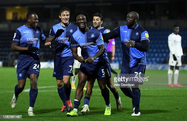 Anthony Stewart of Wycombe Wanderers celebrates with teammates after scoring his sides first goal during the Sky Bet Championship match between...