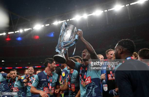 Anthony Stewart of Wycombe Wanderers celebrates with the trophy after winning the Sky Bet League One Play Off Final between Oxford United and Wycombe...
