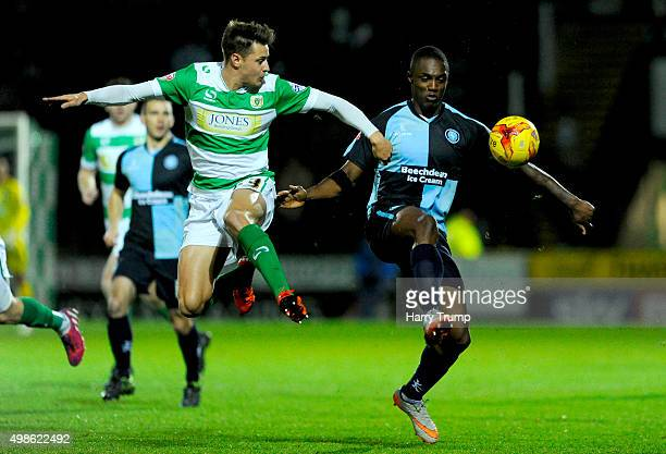 Anthony Stewart of Wycombe Wanderers is tackled by Harry Cornick of Yeovil Town during the Sky Bet League Two match between Yeovil Town and Wycombe...
