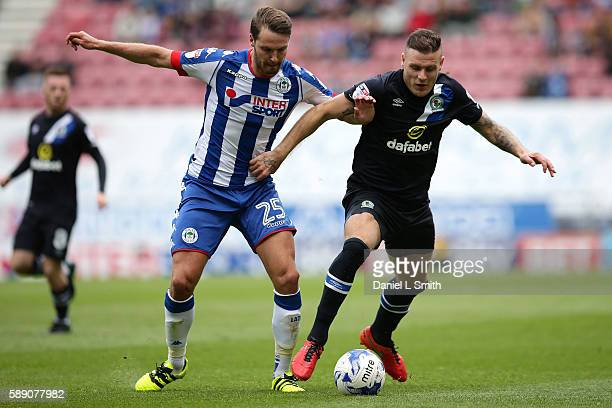 Anthony Stokes of Blackburn Rovers and Nick Powell of Wigan Athletic compete for possession during the Sky Bet Championship League match between...