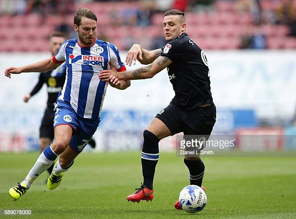 Anthony Stokes of Blackburn Rovers holds off Nick Powell of Wigan Athletic during the Sky Bet Championship League match between Wigan Athletic and...