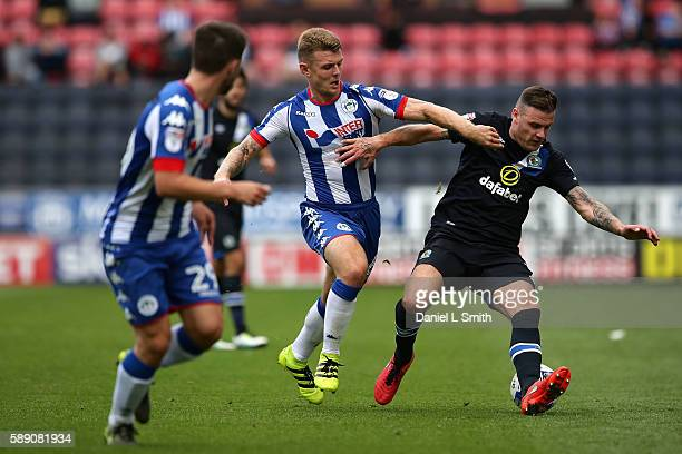 Anthony Stokes of Blackburn Rovers under pressure from Max Power of Wigan Athletic during the Sky Bet Championship League match between Wigan...