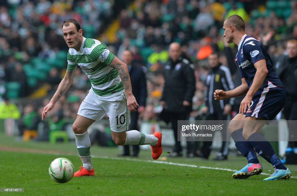 Anthony Stokes of Celtic and Erik Cikos of Ross County challenge during the Scottish Premier League match between Celtic and Ross County at Celtic Park Stadium on March 29, 2014 in Glasgow, Scotland.